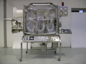 Process isolation systems: flexible canopy isolator for contained micronizing applications