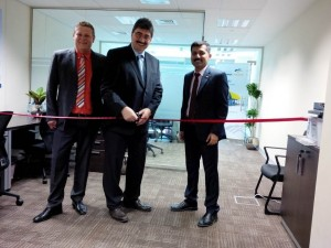 Photo: From left: Robin Steinsdorfer, Gottlieb Hupfer and John Thomas Visakh prepare to cut the ribbon opening the new EnviroChemie FZE office in Dubai.