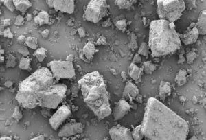 Electron microscope of typical pharma powder sample showing wide variety of particle sizes and shapes.