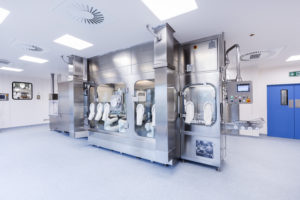 The innovative robotic filling line under an isolator; installed in the clean room in the new AqVida production facility in Dassow, Germany
