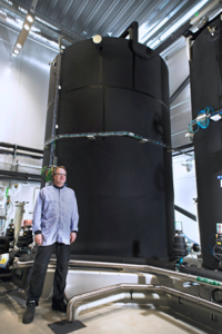 Aurena Process Engineer Magnus Rönnblad with part of the new natural sea water plant