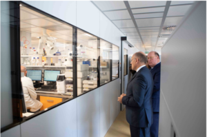 Ambassador McMullen views the advanced Cerbios research facilities at Lugano.