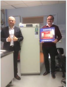 Aivar Tugedam from company G.W.Berg OÜ (left) presents Professor Tõnis Timmusk of TalTech Department of Chemistry and Biotechnology with the University's new MDF-MU300H and Exchange Campaign award