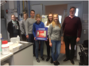 Head of TalTech Department of Chemistry and Biotechnology Professor Tõnis Timmusk (right) and his young laboratory team celebrate winning PHCEU's Exchange Campaign award